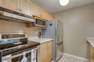 Photo 4: 3303 TUSCARORA Manor NW in Calgary: Tuscany Apartment for sale : MLS®# A1036572