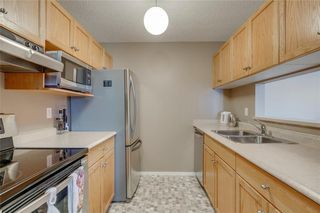 Photo 5: 3303 TUSCARORA Manor NW in Calgary: Tuscany Apartment for sale : MLS®# A1036572