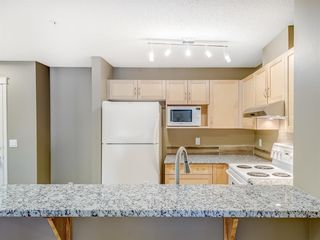 Photo 7: 4110 70 Panamount Drive NW in Calgary: Panorama Hills Apartment for sale : MLS®# A1056107