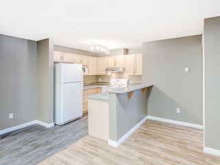 Photo 3: 4110 70 Panamount Drive NW in Calgary: Panorama Hills Apartment for sale : MLS®# A1056107
