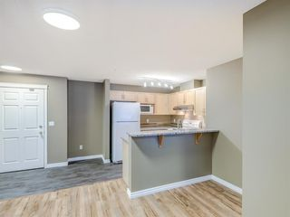 Photo 2: 4110 70 Panamount Drive NW in Calgary: Panorama Hills Apartment for sale : MLS®# A1056107