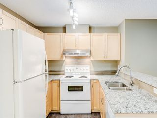Photo 5: 4110 70 Panamount Drive NW in Calgary: Panorama Hills Apartment for sale : MLS®# A1056107