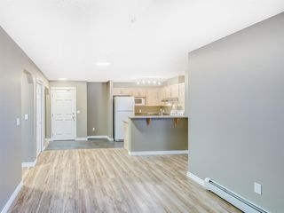 Photo 4: 4110 70 Panamount Drive NW in Calgary: Panorama Hills Apartment for sale : MLS®# A1056107