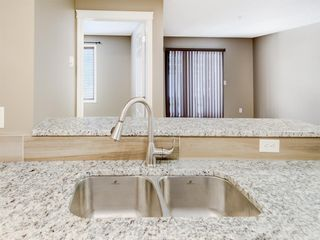 Photo 6: 4110 70 Panamount Drive NW in Calgary: Panorama Hills Apartment for sale : MLS®# A1056107