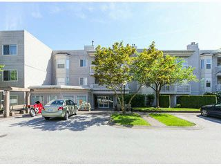 """Photo 1: 309 9942 151ST Street in Surrey: Guildford Condo for sale in """"WINCHESTER"""" (North Surrey)  : MLS®# F1412007"""