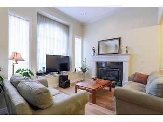 Photo 2: 7770 16TH AVE - LISTED BY SUTTON CENTRE REALTY in Burnaby: East Burnaby House 1/2 Duplex for sale (Burnaby East)  : MLS®# V1113476
