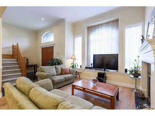 Photo 3: 7770 16TH AVE - LISTED BY SUTTON CENTRE REALTY in Burnaby: East Burnaby House 1/2 Duplex for sale (Burnaby East)  : MLS®# V1113476