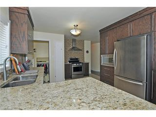 Photo 7: 203 41 Avenue NW in Calgary: Highland Park House for sale : MLS®# C4035983