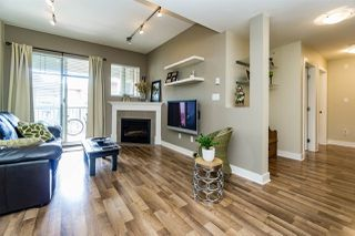 "Photo 1: 411 2468 ATKINS Avenue in Port Coquitlam: Central Pt Coquitlam Condo for sale in ""THE BORDEAUX"" : MLS®# R2062681"