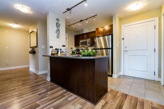 "Photo 4: 411 2468 ATKINS Avenue in Port Coquitlam: Central Pt Coquitlam Condo for sale in ""THE BORDEAUX"" : MLS®# R2062681"