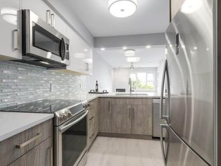 "Photo 12: 312 4893 CLARENDON Street in Vancouver: Collingwood VE Condo for sale in ""CLARENDON PLACE"" (Vancouver East)  : MLS®# R2216672"