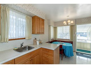 Photo 5: 4327 ATLIN Street in Vancouver: Renfrew Heights House for sale (Vancouver East)  : MLS®# V1068051