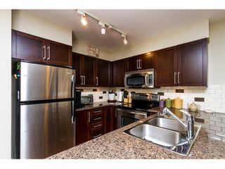 "Photo 6: 316 2468 ATKINS Avenue in Port Coquitlam: Central Pt Coquitlam Condo for sale in ""BOURDEAUX"" : MLS®# R2046100"