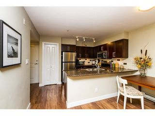 "Photo 3: 316 2468 ATKINS Avenue in Port Coquitlam: Central Pt Coquitlam Condo for sale in ""BOURDEAUX"" : MLS®# R2046100"