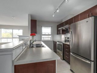 """Photo 5: 405 7088 MONT ROYAL Square in Vancouver: Champlain Heights Condo for sale in """"BRITTANY"""" (Vancouver East)  : MLS®# R2220776"""
