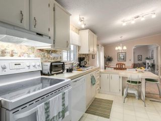 Photo 2: 6 145 KING EDWARD Street in Coquitlam: Coquitlam East Manufactured Home for sale : MLS®# R2248856