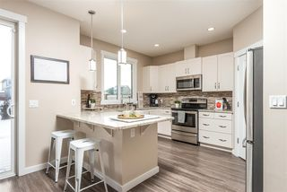 Photo 1: 13009 205 Street in Edmonton: Zone 59 House Half Duplex for sale : MLS®# E4139675
