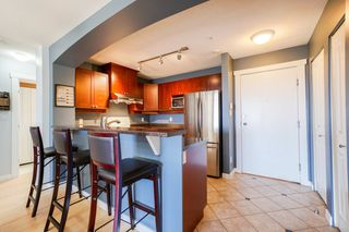 Photo 4: 102 1438 PARKWAY Boulevard in Coquitlam: Westwood Plateau Condo for sale : MLS®# R2342793