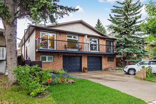 Photo 2: 3719 42 Street SW in Calgary: Glenbrook Duplex for sale : MLS®# A1015771