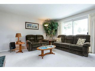 Photo 3: 9211 PRINCE CHARLES Boulevard in Surrey: Queen Mary Park Surrey House for sale : MLS®# F1409362