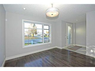 Photo 2: 302 31 Avenue NE in Calgary: Tuxedo House for sale : MLS®# C3649453
