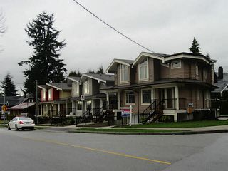 Photo 1: 7381 STRIDE Avenue in Burnaby: Edmonds BE House 1/2 Duplex for sale (Burnaby East)  : MLS®# V1100560
