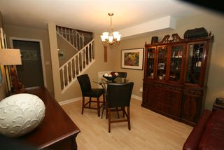 "Photo 2: 52 65 FOXWOOD Drive in Port Moody: Heritage Mountain Townhouse for sale in ""FOREST HILL"" : MLS®# R2012427"