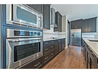 Photo 8: 14 ROCKFORD Road NW in Calgary: Rocky Ridge House for sale : MLS®# C4048682