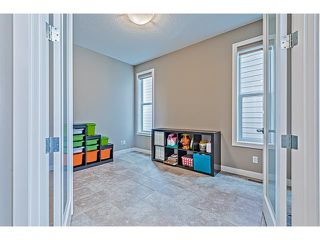 Photo 15: 14 ROCKFORD Road NW in Calgary: Rocky Ridge House for sale : MLS®# C4048682