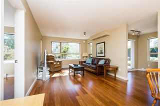 "Photo 4: 105 600 KLAHANIE Drive in Port Moody: Port Moody Centre Condo for sale in ""BOARDWALK"" : MLS®# R2111102"