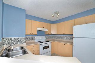 Photo 5: 1306 12 CIMARRON Common: Okotoks Condo for sale : MLS®# C4181710