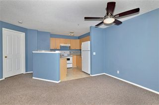 Photo 3: 1306 12 CIMARRON Common: Okotoks Condo for sale : MLS®# C4181710