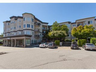 """Photo 1: 313 5759 GLOVER Road in Langley: Langley City Condo for sale in """"College Court"""" : MLS®# R2426303"""