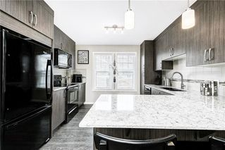 Photo 4: 214 Cranbrook Square SE in Calgary: Cranston Row/Townhouse for sale : MLS®# C4299196