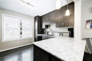 Photo 3: 214 Cranbrook Square SE in Calgary: Cranston Row/Townhouse for sale : MLS®# C4299196