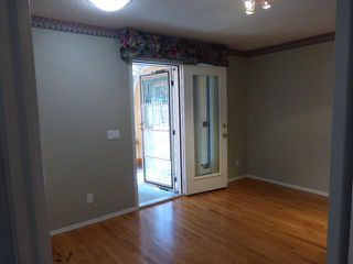Photo 9: 205 ARBOUR CLIFF Close NW in CALGARY: Arbour Lake Residential Attached for sale (Calgary)  : MLS®# C3614284
