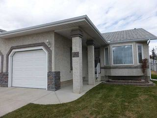 Photo 1: 205 ARBOUR CLIFF Close NW in CALGARY: Arbour Lake Residential Attached for sale (Calgary)  : MLS®# C3614284