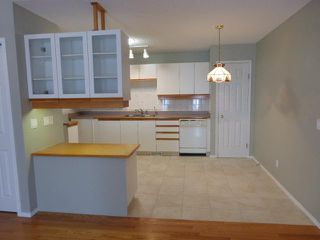 Photo 7: 205 ARBOUR CLIFF Close NW in CALGARY: Arbour Lake Residential Attached for sale (Calgary)  : MLS®# C3614284