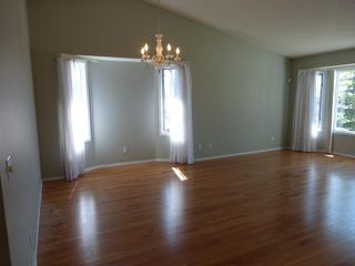 Photo 4: 205 ARBOUR CLIFF Close NW in CALGARY: Arbour Lake Residential Attached for sale (Calgary)  : MLS®# C3614284