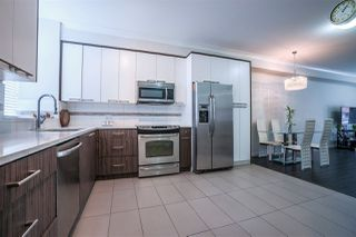 Photo 4: 105 7533 GILLEY Avenue in Burnaby: Metrotown Townhouse for sale (Burnaby South)  : MLS®# R2078650