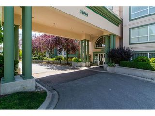 "Photo 1: 212 13860 70 Avenue in Surrey: East Newton Condo for sale in ""CHELSEA GARDENS"" : MLS®# R2096259"