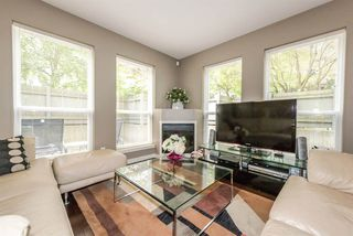 "Photo 1: 103 4155 CENTRAL Boulevard in Burnaby: Metrotown Townhouse for sale in ""PATTERSON PARK"" (Burnaby South)  : MLS®# R2274386"