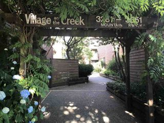 "Photo 1: 3311 MOUNTAIN Highway in North Vancouver: Lynn Valley Townhouse for sale in ""VILLAGE ON THE CREEK"" : MLS®# R2287657"