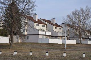 Main Photo: 105 Lancaster Terrace in Edmonton: Zone 27 Townhouse for sale : MLS®# E4131873
