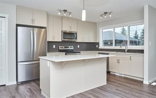 Photo 11: 5672 JUCHLI Avenue in Edmonton: Zone 27 Attached Home for sale : MLS®# E4172073