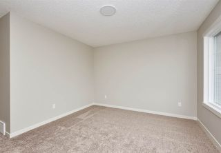 Photo 16: 5672 JUCHLI Avenue in Edmonton: Zone 27 Attached Home for sale : MLS®# E4172073