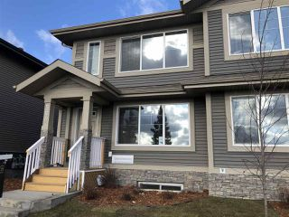 Photo 1: 5672 JUCHLI Avenue in Edmonton: Zone 27 Attached Home for sale : MLS®# E4172073