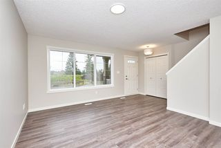 Photo 2: 5672 JUCHLI Avenue in Edmonton: Zone 27 Attached Home for sale : MLS®# E4172073