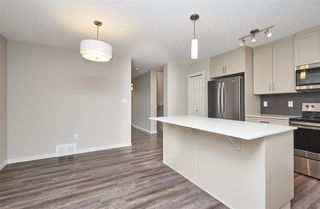 Photo 6: 5672 JUCHLI Avenue in Edmonton: Zone 27 Attached Home for sale : MLS®# E4172073