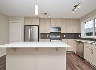 Photo 7: 5672 JUCHLI Avenue in Edmonton: Zone 27 Attached Home for sale : MLS®# E4172073